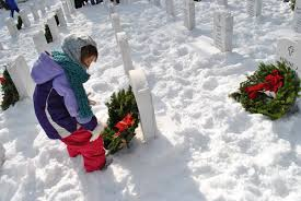 six year old abigail garrison of shapleigh places a wreath on her grave of