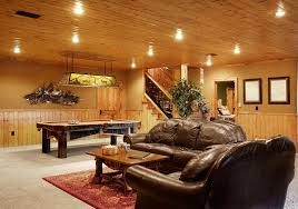 large man cave featuring wooden ceiling and carpet flooring the brown leather sofa seats look