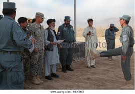 u s army released oef diploma stock photos u s army released oef  an afghan national police student right es toward hajy khuday rahim the governor