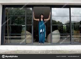 opening front door. Woman Opening Front Door \u2014 Stock Photo A