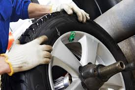 covina auto repair maintenance shop johnny s covina auto repair technician balances new tires