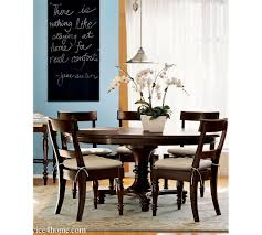 dark cherry hardwood round dining table design and chair design in dining room
