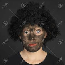 stock photo white girl who painted her face black with charcoal black background