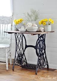 repurposed antique sewing machine base turned into a rustic farmhouse accent table with pallet wood table