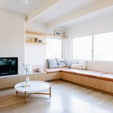 a mid century modern living room with a built in banquette seating covered with