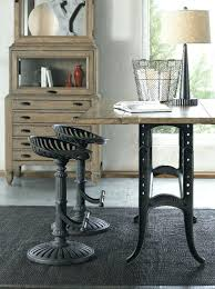 wolf creek tractor seat stools adjule width sofa table thomasville bar ernest hemingway stool