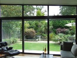 three pane sliding door with electric blinds with reinforced head to take the weight of the fixed shaped window above