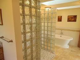 larger completed bathroom remodel with walk in glass block shower and acrylic pedestal tub