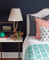 orange and navy blue bedroom. rock me to sleep: nautical doesn\u0027t mean that everything has be blue and white. au contraire! adding accent colors like orange turquoise will really navy bedroom