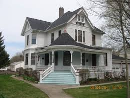 Beautiful White Eastlake Queen Anne Victorian Style House with L-Shaped  Porch & Black Roof