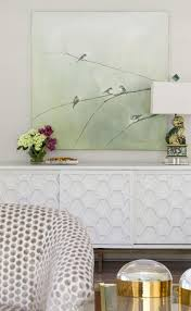 white honeycomb credenza with foo dog lamp