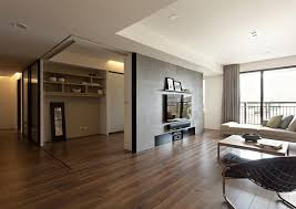 dazzling apartment style living room decoration with concrete grey wall divider and brown laminate wooden floor also laminate wooden floor plus open wall