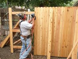 how to put up a wood fence concrete for fence post best way to put in wooden fence posts