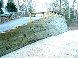 retaining wall steel posts with railway sleepers metal wood ideas how to build a stee