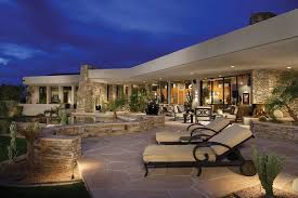 contemporary flagstone patio with stacked stone benches and desert landscaping
