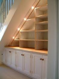 under stairs furniture. under stair closet redone into storage stairs furniture e