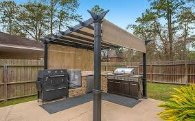 outdoor kitchen with charcoal grill and smoker designs