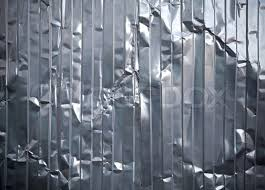 Corrugated metal rumpled sheet background texture Stock Photo