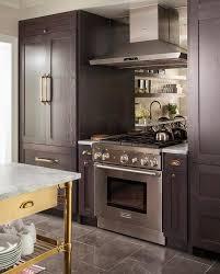 french door refrigerator in kitchen. Dark Brown Paneled French Door Refrigerator With Brass Handle In Kitchen R