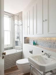 design ideas for a victorian bathroom in london with a console sink white cabinets