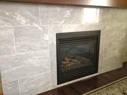 interior grey ceramic fireplace with dark brown mantel shelf and square black metal fire box