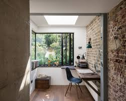 office industrial design.  industrial urban builtin desk dark wood floor home office photo in london with white  walls throughout office industrial design
