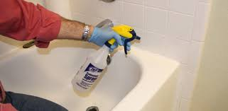 misting a bead of silicone caulking with denatured alcohol to make it easy to spread