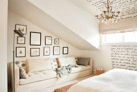 bedroom that has a sloped roof