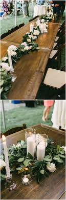 Outdoor wedding reception table decor, long wooden tables, garlands of  pastel flroals and leaves