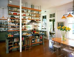 industrial kitchen with ceiling hung shelves and an island with open shelves as well