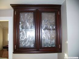 stained upper cabinets with rope molding and frosted glass i