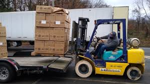 Harvest Community Charities distributes Christmas food boxes to ...