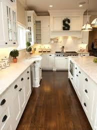 white kitchen wood floor. Fine Kitchen White Cabinets With Wood Floors Kitchen Shaker Hardwood Floor  Black Pulls For White Kitchen Wood Floor H