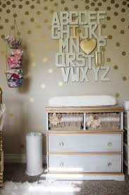 A gorgeous girly gold nursery - loving the diy wall art above this changing  table