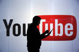 office youtube. Image: A Man Stands In Front Of YouTube\u0027s Logo At An Office London Youtube