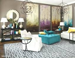 white and black accent chair living room decor idea with white fabric couch and accent chair also teal ottoman under 2 antique chandeliers also artistic
