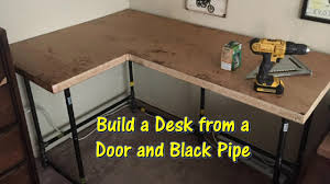 Build a Desk Using an Old Door and Black Pipe by @GettinJunkDone