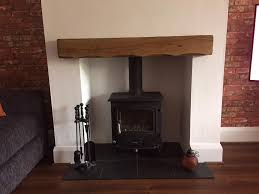 air dried oak mantelpiece or green celtic timber wooden beam above fireplace oak beams wooden beam above fireplace