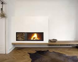 Frei Schwebende Kaminfeuerung Mit Integrierter Holzablage