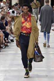 as the hot humid heat filled the plastic tent that was to showcase kim jones latest designs for louis vuitton s spring summer 2018 collection