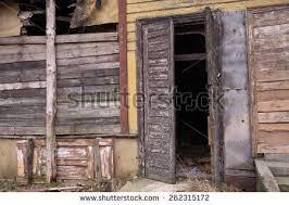 an old dilapidated wooden door open