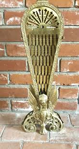 antique brass fireplace screen folding peacock fan style with gargoyle griffin for in denver co offerup