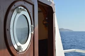 vacation travel transportation vessel vehicle journey metal frame holiday island blue tourism leisure circle life porthole cruise