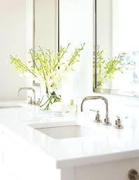 white quartz vanity top a white dual bath vanity is fitted with a glossy white quartz boasting square curved sinks with polished nickel modern faucet kits