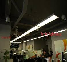 linear suspended fluorescent light fixture with a recessed down lights modern conference room lighting associates lighting office lighting conference room