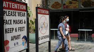 With virus cases rising, mask mandate ...