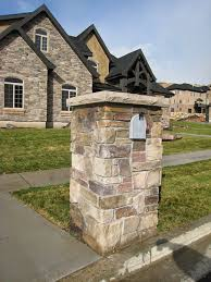 stone mailbox. Or This Business Above, Home Below. Stone Mailbox