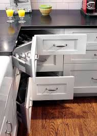 ... Shaker style kitchen with an L-shaped layout maximizes storage space  with corner pullout drawers