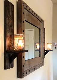 rustic wall sconces and rustic studded frame mirror