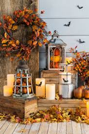 Fill lanterns with pumpkins and other fall pieces for an easy DIY-decor idea .